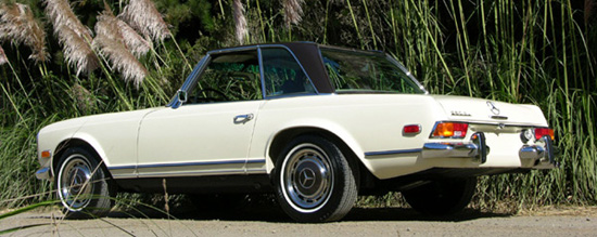 Progressive engine enlargements ended with the 2.8 liter 280SL constructed from 1968-1971. This restored example is finished in a two-tone of dark brown poly over ivory.