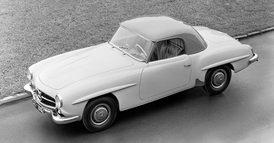 Final design carried most of the styling cues found on the iconic 300SL roadster with the notable absence of front fender side grilles. This car is fitted with the first series small back window hard top. It is also a factory 'two-tone' with wheel covers and hard top in a contrasting color to main body.