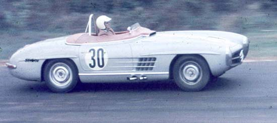 This period photo of Paul O'Shea at speed in the SLS reveals many differences from standard 300SL Roadster: side exhaust, small windscreen, solid tonneau cover over passenger seat and cowl air scoop.