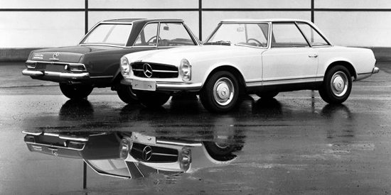 "Concave 'Pagoda' roofline allowed higher entry/exit head room while preserving the illusion of a low roofline. These are European model 230SLs. If you look closely to the darker car's tail you will see ""Automatic"" script. US cars lacked this designation."
