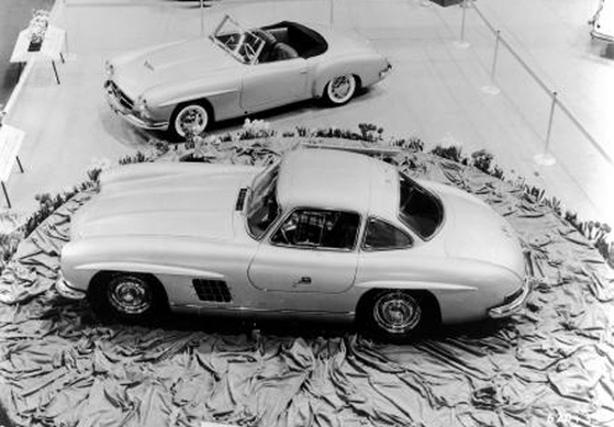 Pride of place: The Gullwing debuts in 1954. Note prototype 190SL in background.